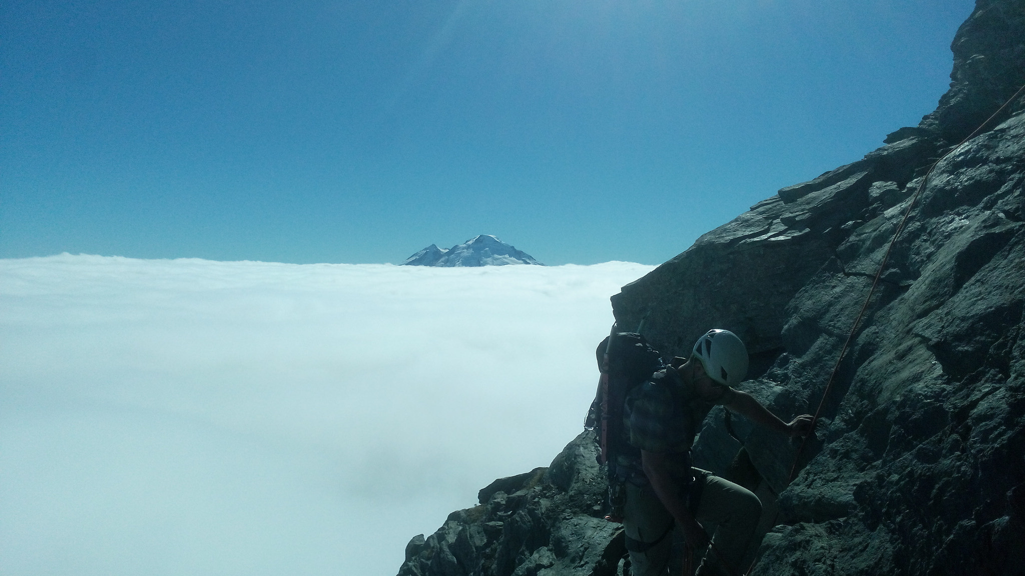 Climbing on some rock with Mt Baker in the background