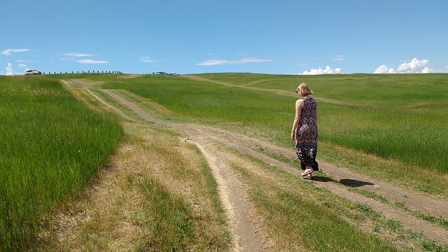 Dorothy walking up a small hill